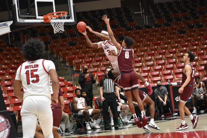 John Knight III flies to the basket against Montana on Thursday, December 3, 2020.