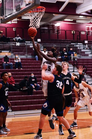 Elijah Hinton goes up for a shot in the lane during the second quarter of Newark's 87-47 win against Zanesville on Saturday night at Jimmy Allen Gymnasium.