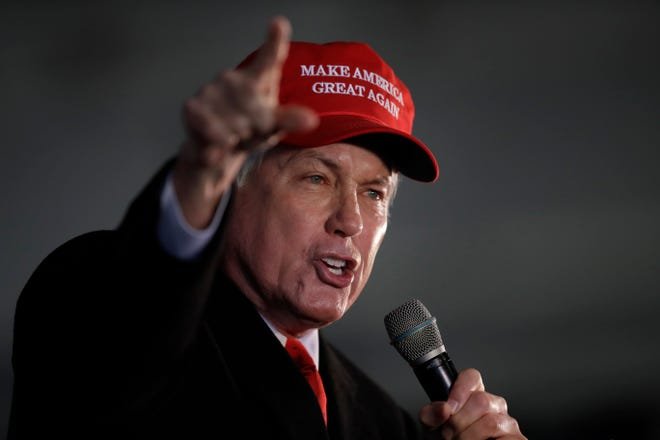 Attorney Lin Wood, member of President Donald Trump's legal team, gestures while speaking during a rally on Friday, Dec. 2, 2020, in Alpharetta, Georgia.