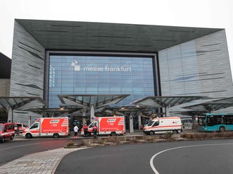 Ambulances and fire trucks are seen on December 6, 2020 at Hall 11 of Messe Frankfurt in Frankfurt am Main, western Germany, where people from the Gallus area were evacuated.