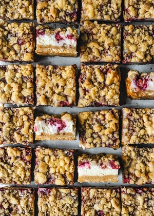 "These raspberry cheesecake squares are from Edd Kimber's ""One Tin Bakes."""