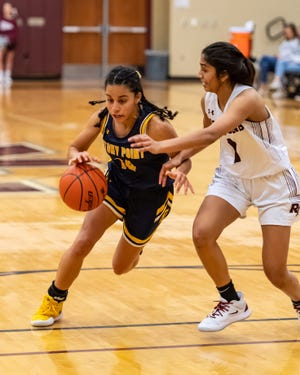 Ariana Rosado, left, scored 22 points with 10 rebounds, six steals and six assists in a win over McNeil in the District 25-6A opener Friday.