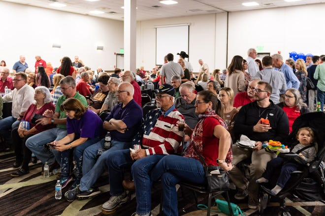 The Williamson County Republican Party, members shown here awaiting election results in November 2018, will hold a Christmas potluck Monday despite health officials warning against large gatherings due to concerns about spreading COVID-19.