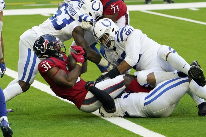 Houston Texans running back David Johnson scores a touchdown during the Texans' 26-20 loss to the Indianapolis Colts Sunday in Houston.