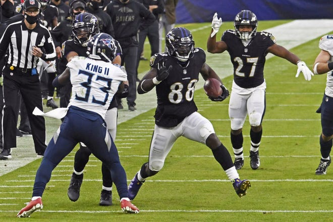 Baltimore Ravens wide receiver Dez Bryant picks up yardage after a catch against Tennessee in November. The former Dallas Cowboys star will face his old team for the first time Tuesday.