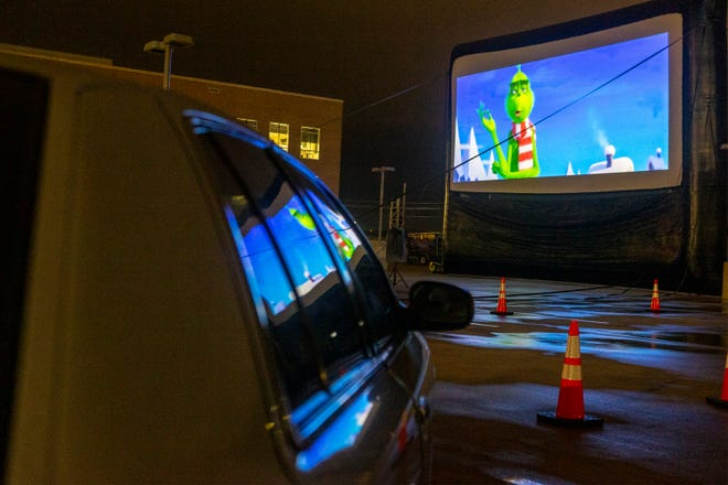 """The Roussett family watches """"Dr. Seuss' The Grinch"""" during the holiday drive-in movie event Saturday at Domain Northside. The Roussetts are part of the Statesman Season for Caring program and were invited to enjoy the movie for free."""