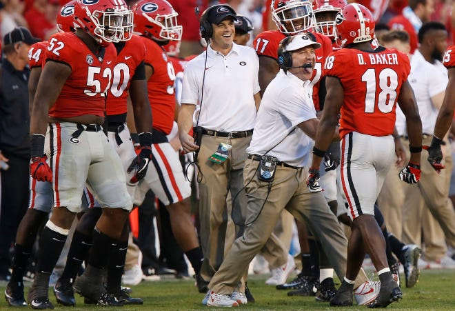 Georgia coach Kirby Smart celebrates with cornerback Deandre Baker (18) after a defensive stop in the second half against South Carolina on Saturday, Nov. 4, 2017, in Athens, Ga. (Joshua L. Jones/Athens Banner-Herald via AP)