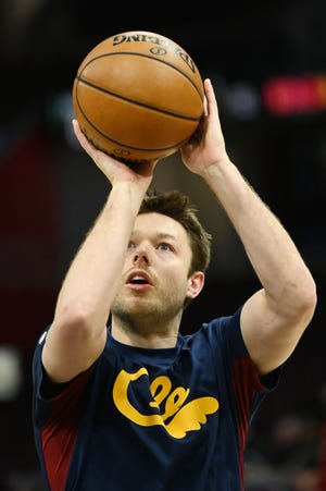 Mar 4, 2020; Cleveland, Ohio, USA;  Cleveland Cavaliers guard Matthew Dellavedova (18) warms up before the game at Rocket Mortgage FieldHouse.