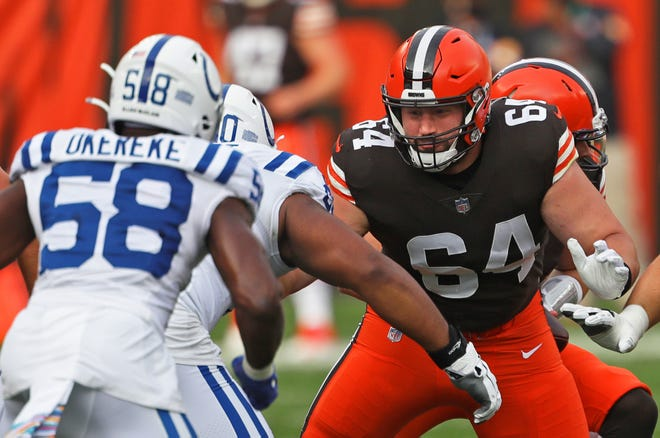 Browns center JC Tretter (64) blocks for Baker Mayfield during the first quarter against the Indianapolis Colts, Sunday, Oct. 11, 2020, in Cleveland, Ohio. [Jeff Lange/Beacon Journal]