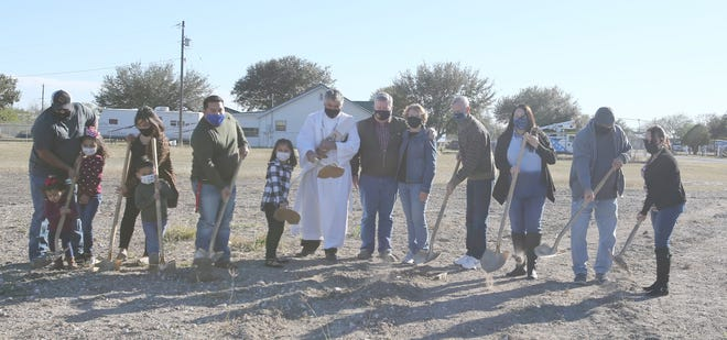 JWC Habitat for Humanity, the Ramos family and Deacon Emede Gonzalez broke ground on the site of the Ramos' future home.