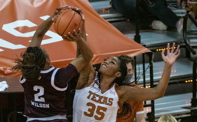 Texas junior Charli Collier (35) blocks a shot by Texas A&M's Aailyah Wilson (2) in Austin on Dec. 6, 2020.