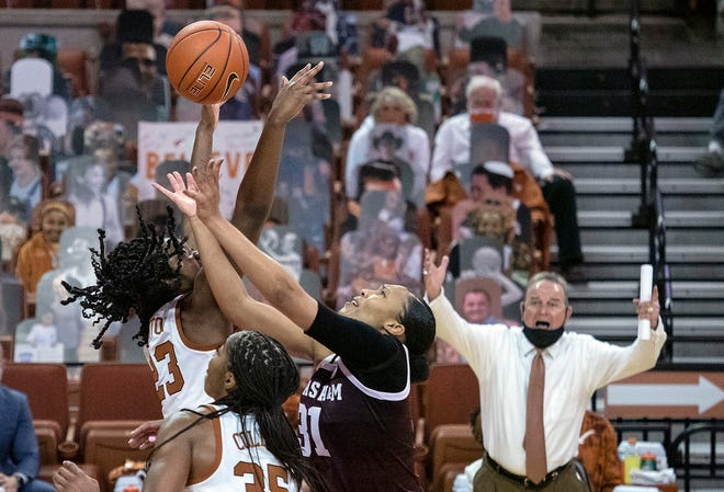 Texas' DeYona Gaston, left, and Charli Collier battle with Texas A&M's N'dea Jones for a rebound in front of UT coach Vic Schaefer on Sunday night at the Erwin Center.
