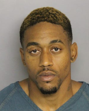 Domique Johson was arrested Monday for the murder of James Johnson.