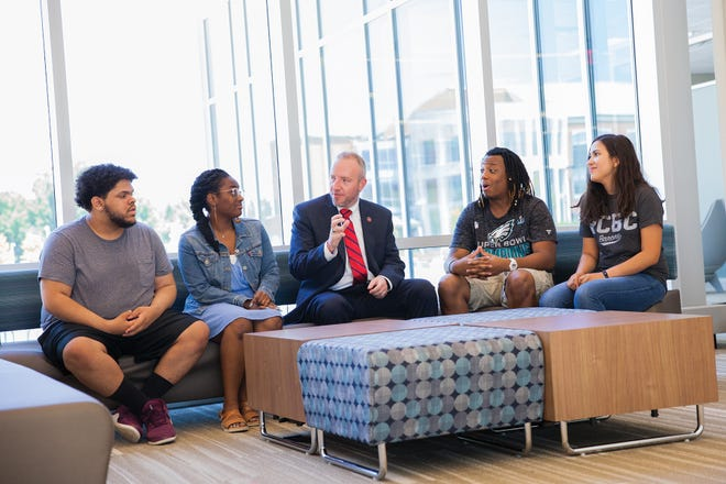 RCBC President Michael Cioce, center, talks to students on the school's Mount Laurel campus. (This picture was taken before the coronavirus pandemic, as no one is wearing masks or social distancing.)