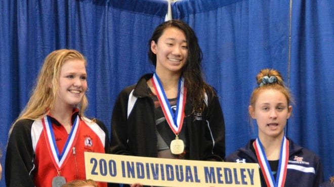Sewickley Academy's Isabel Huang, center, has won back-to-back WPIAL titles in the 200 individual medley and 100 backstroke while swimming for Quaker Valley.