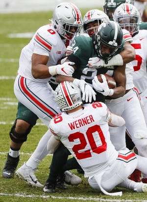 Ohio State takes it as a pretty good sign that it can win by 40 points on the road at Michigan State despite missing 23 players to COVID-19 concerns or injury.