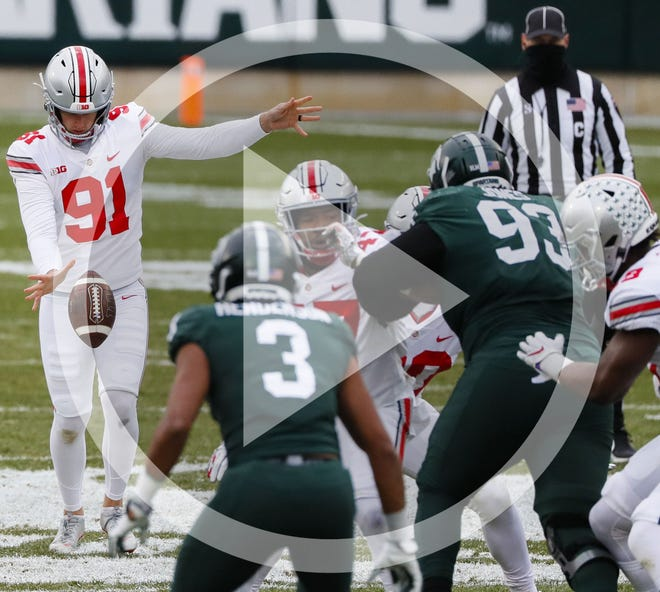Ohio State Buckeyes punter Drue Chrisman (91) punts the ball during the second quarter of a NCAA Division I football game between the Michigan State Spartans and the Ohio State Buckeyes on Saturday, Dec. 5, 2020 at Spartan Stadium in East Lansing, Michigan.