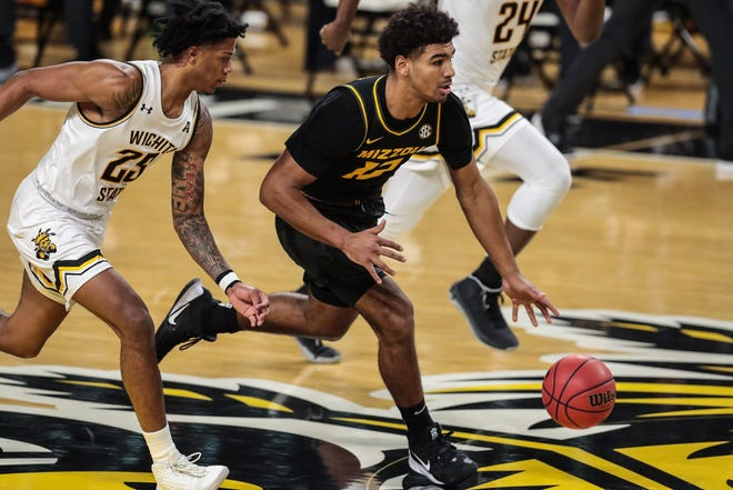 Missouri guard Mark Smith (13) dribbles the ball against Wichita State during a game Sunday afternoon at Charles Koch Arena in Wichita, Kan.