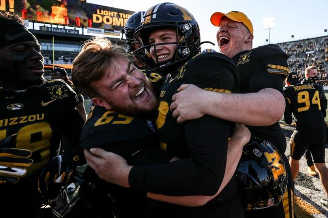 Missouri place kicker Harrison Mevis (92) celebrates with offensive linemen Drake Heismeyer (69) and D.J. Bullard (71) after Mevis' game-winning 32-yard field goal against Arkansas as time expired Saturday at Faurot Field.