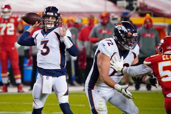 Denver Broncos quarterback Drew Lock (3) throws a pass during the second half against the Kansas City Chiefs on Sunday night at Arrowhead Stadium in Kansas City.