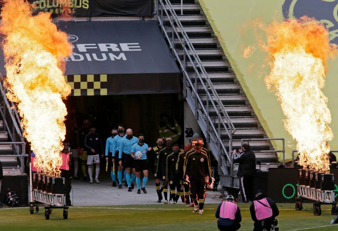 Columbus Crew SC and the New England Revolution players walk onto the field for Sunday's MLS Eastern Conference final at Mapfre Stadium in Columbus, Oh., on December 6, 2020.