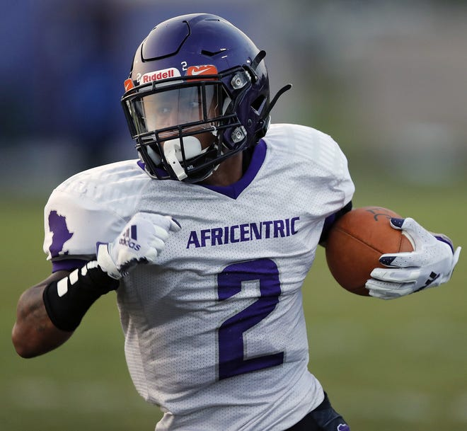 Africentric's Justin Fudge (2) carries the ball against Briggs during the 1st quarter of their game at Briggs High School in Columbus, Ohio on September 24, 2020.