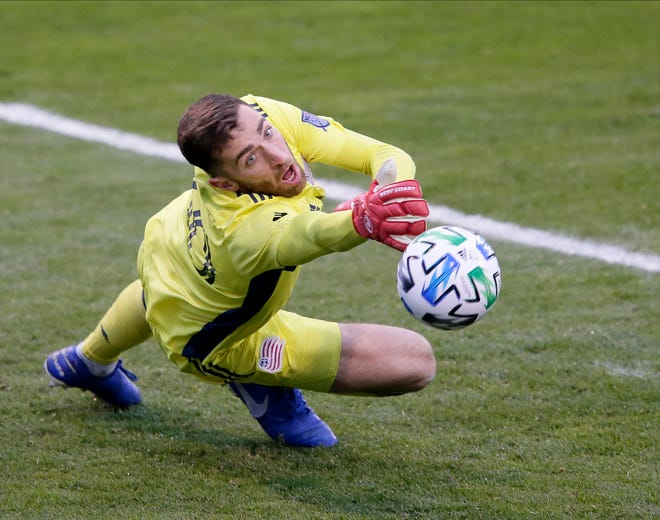 New England Revolution goalkeeper Matt Turner (30) deflects a shot on goal during the second half of Sunday's MLS Eastern Conference Final playoff match against Columbus Crew SC at Mapfre Stadium in Columbus, Oh., on December 6, 2020.