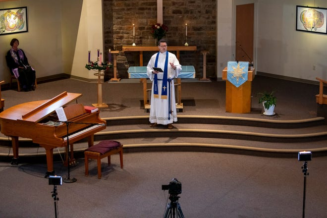 Reverend Daniel Doty conducts Sunday morning service at Westerville Community United Church of Christ as parishioners watch an online stream from home on Nov. 29, 2020.