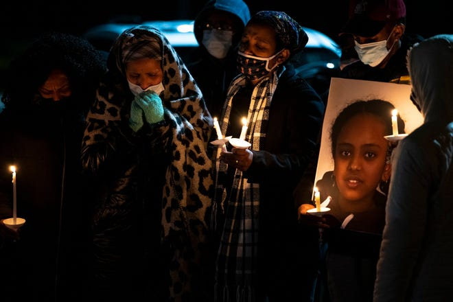 Family, friends and community members gather outside Tussing Elementary School to hold a candlelight vigil on Sunday for 12-year-old Lidia Ghide, who was killed last week when a neighbor's rifle was unintentionally fired.