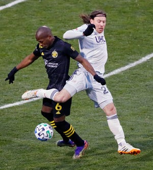 Columbus Crew SC midfielder Darlington Nagbe (6) controls the ball from New England Revolution midfielder Thomas McNamara (26) in the second half during the MLS Eastern Conference Final at MAPFRE Stadium in Columbus, Ohio on December 6, 2020.