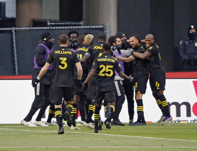 The Crew celebrates Artur's game-winning goal against New England on Sunday.
