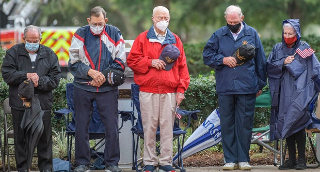 World War II veterans bow their heads in prayer at a Pearl Harbor Day ceremony at Veterans Memorial Park in The Villages on Monday, Dec. 7, 2020. [PAUL RYAN / CORRESPONDENT]