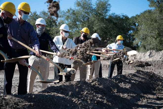 City and state officials along with the contractors break ground at the ceremony for the Turnpike Wastewater Treatment Facility on Thursday. [Cindy Peterson/Correspondent]