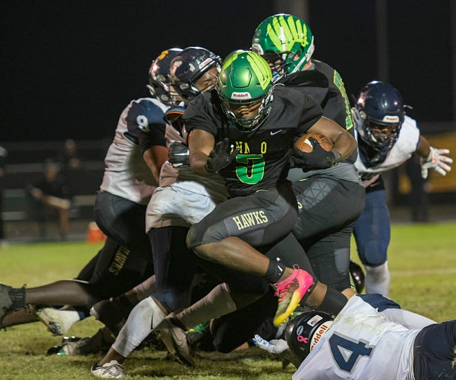 Lake Minneola's Duke Walker (5) leaps over a defender during Friday's Class 6A-Region 2 championship game against Tampa Gaither in Minneola. [PAUL RYAN / CORRESPONDENT]