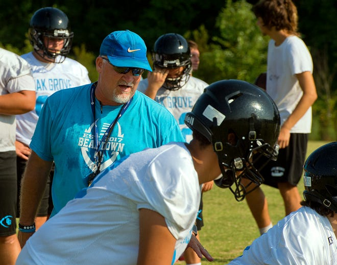 Oak Grove head coach Mark Holcomb instructs his team during practice prior to the 2019 season.