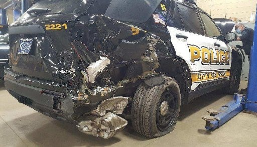 An Erie Bureau of Police Interceptor patrol vehicle was heavily damaged when police said it was struck from behind by a woman suspected of driving under the influence early Sunday morning.