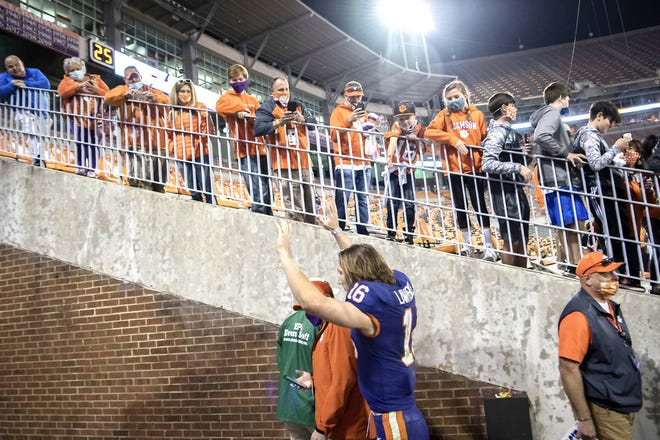 Clemson quarterback Trevor Lawrence waves to fans as he leaves the team's field after the team's Nov. 28 win over Pittsburgh in Clemson, South Carolina. Lawrence could be a factor in at least one of this season's Week 17 NFL games.