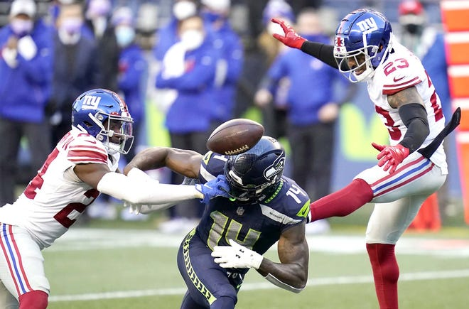 New York Giants defensive backs James Bradberry and defensive back Logan Ryan (from left) break up a pass intended for Seattle Seahawks receiver DK Metcalf (14) during the second half of Sunday's game in Seattle. The Giants won 17-12.