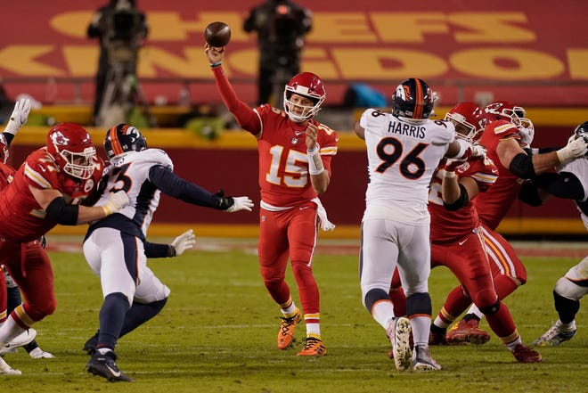 Kansas City Chiefs quarterback Patrick Mahomes (15) throws a pass against the Denver Broncos in the second half of Sunday's game at Arrowhead Stadium. The Chiefs went on to win 22-16 to clinch a playoff berth.