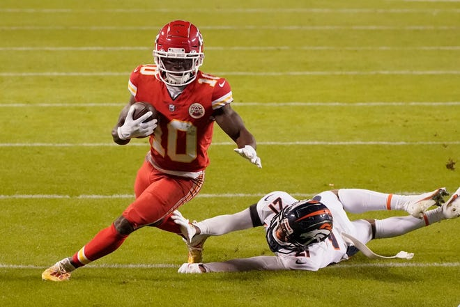Kansas City Chiefs wide receiver Tyreek Hill avoids Denver Broncos cornerback A.J. Bouye in Sunday's game at Arrowhead. The Chiefs went on to a 22-16 win to improve to 11-1 and clinch a playoff spot. Hill should remain near the top of our fantasy football rankings for Week 14.