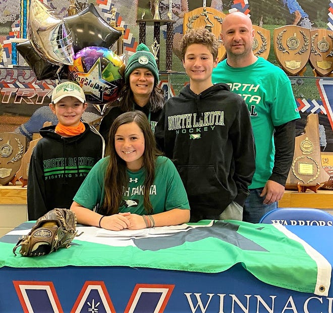 Winnacunnet High School senior Hannah Thompson, front, has signed her National Letter of Intent to play softball at the University of North Dakota. Thompson is joined by her parents, Shaun and Amy, and brothers, Devin, left, and Brady.
