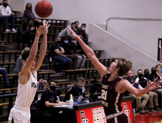 Providence guard Alan Prameshuber (left) takes a 3-point shot as St. Augustine's Jacob Nelson goes for the block at the Dom's Light Tournament.