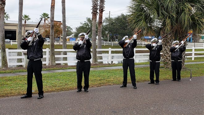 The Beaches Honor Guard fire a rifle salute on Monday to honor those who died 79 years ago on the Japanese attack on Pearl Harbor.