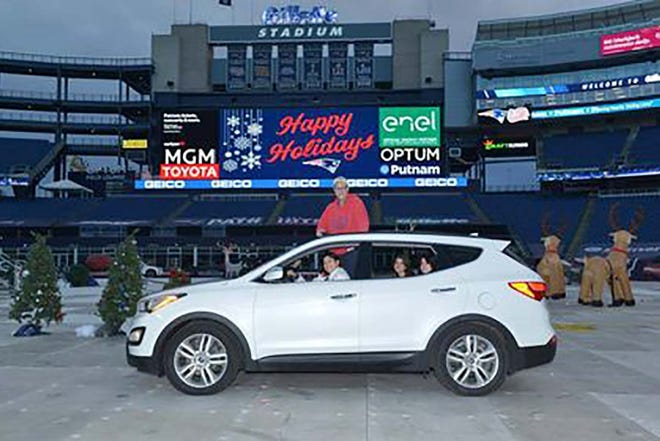 The Crowley family — Katherine, Michael, Michaela and Marissa — had their picture taken in front of the Gillette Stadium scoreboard during their driving tour of the facility with other Patriots' season-ticket holders last week.