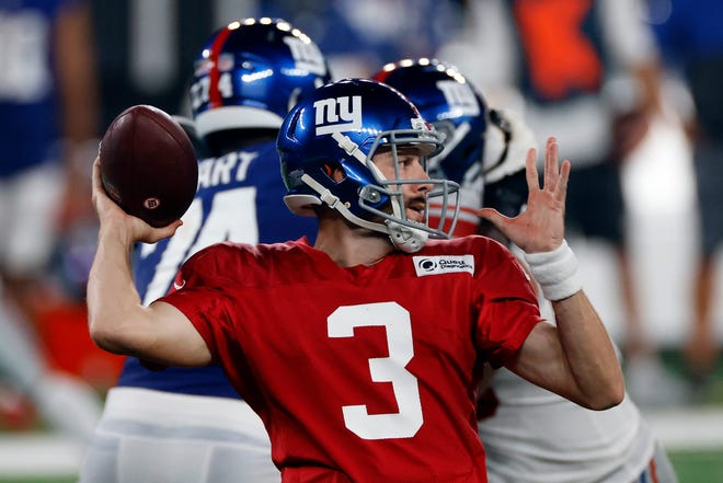 New York Giants quarterback Alex Tanney (3) passes during a scrimmage at the NFL football team's training camp in East Rutherford, N.J., Friday, Aug. 28, 2020.