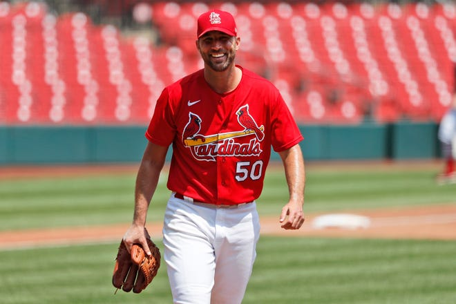 St. Louis Cardinals pitcher Adam Wainwright smiles after throwing a simulated inning during baseball practice at Busch Stadium in St. Louis on Sunday, July 5. [AP Photo/Jeff Roberson]