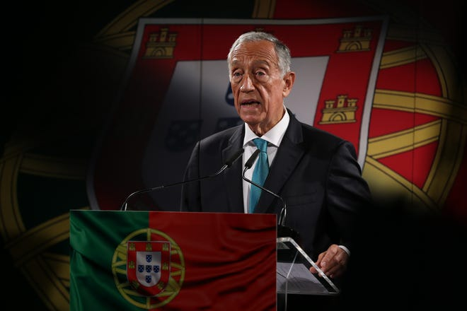 Portugal's President Marcelo Rebelo de Sousa announces he will be running for reelection on Jan. 24, 2021 at the Versailles Bakery in Lisbon.