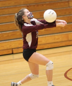 Dixon's Lilly Williard delivers a set Friday in a match against Dixon. [Chris Miller / The Daily News]