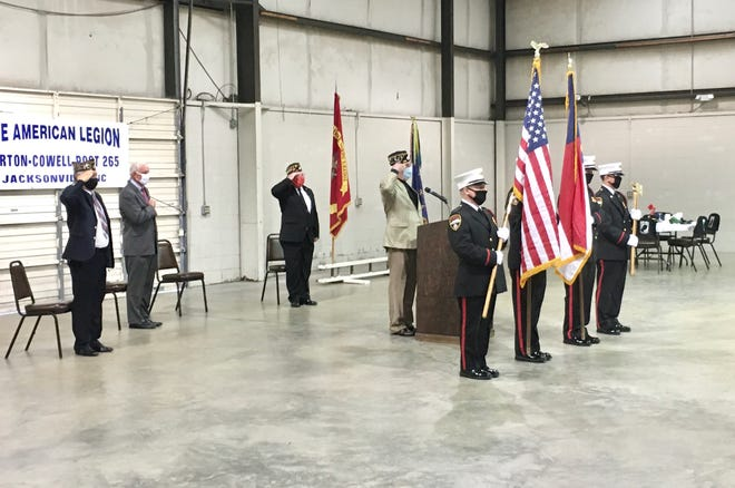 The Jacksonville Fire Department Color Guard retires the colors near the end of a Pearl Harbor Remembrance Day ceremony held at The American Legion Burton-Cowell Post 265 in Jacksonville, Dec. 7.