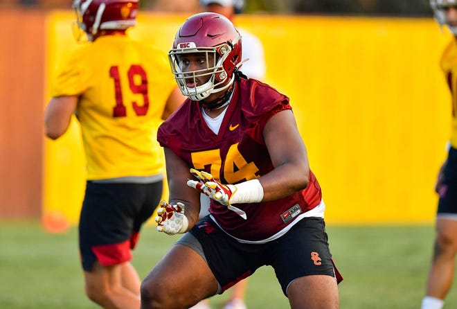 Courtland Ford, the son of former Manual basketball player Clint Ford, is a freshman offensive lineman for Southern California.